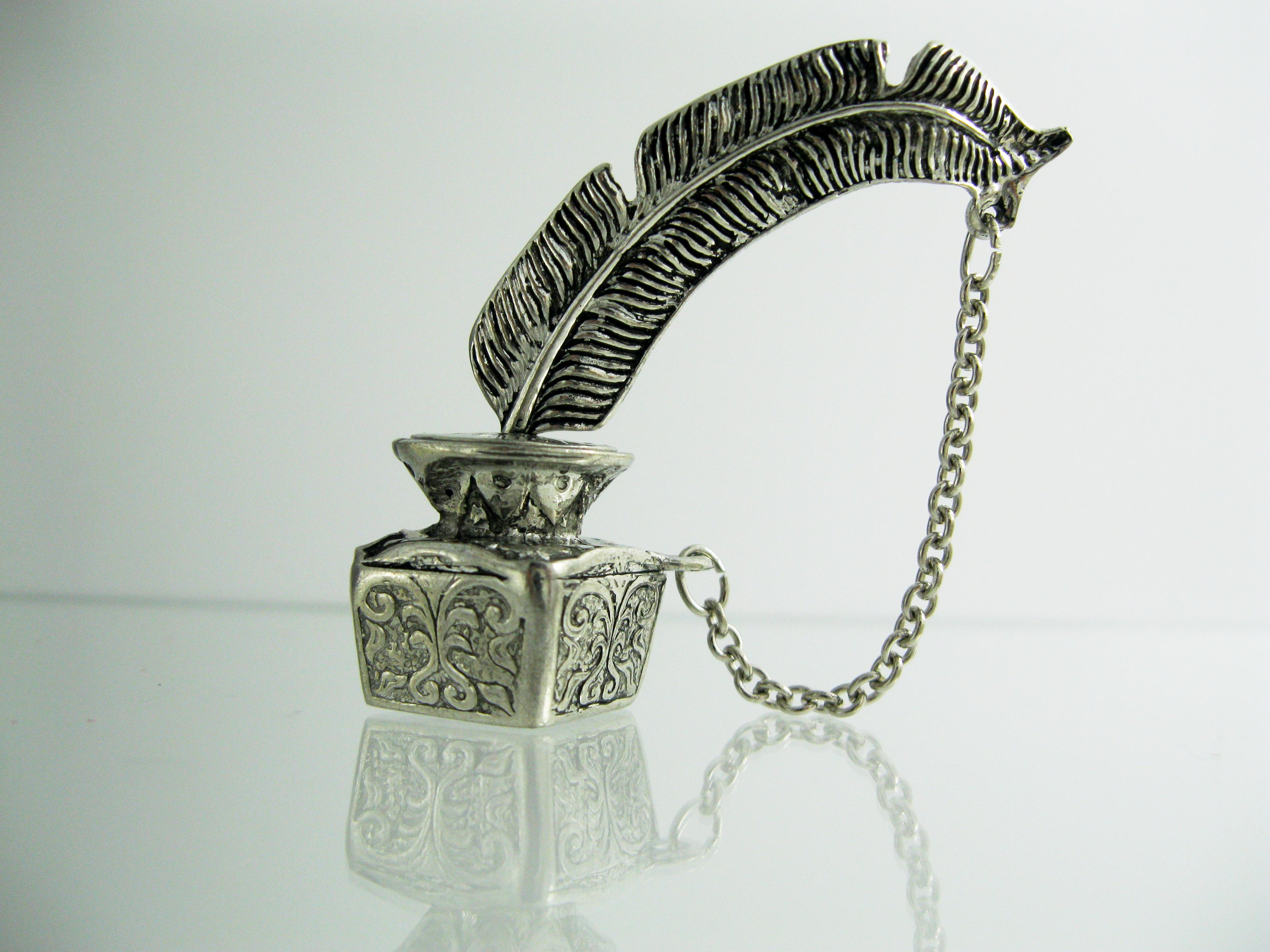 Bomboniere argento laurea penna piuma d 39 oca bomboniera for Laurea in design